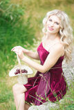 Woman with berries in basket Stock Photo