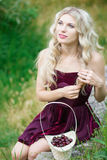 Woman with berries in basket Royalty Free Stock Images