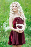 Woman with berries in basket Stock Image
