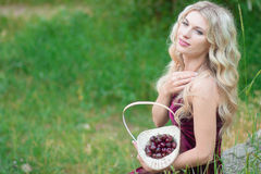 Woman with berries in basket Stock Photography