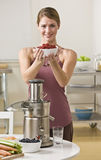 Woman with berries and juicer Royalty Free Stock Image