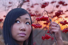 Woman with berry. In hand stock image