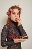 Woman with berry Stock Photography