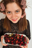 Woman with berry Stock Photo