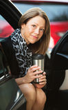 Woman with Beverage in Car Royalty Free Stock Photo