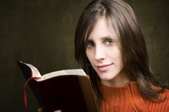 Woman with Bible royalty free stock image