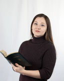 A woman with a bible Stock Images