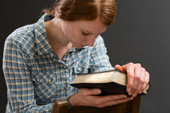 Woman with a Bible Praying Royalty Free Stock Photo