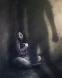 Woman with Bible and shadow. Stock Photo