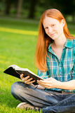 A Woman with a Bible Smiling at the Camera Stock Photography