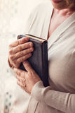 Woman with bible Stock Image