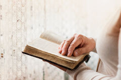 Woman with bible Royalty Free Stock Photography