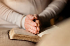 Woman with bible Stock Photography
