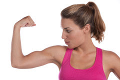 Woman bicep. A fit woman is happy with her toned bicep Royalty Free Stock Photography