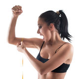 Woman bicep. Young girl measuring tape around womans bicep Stock Images
