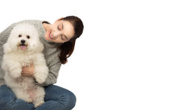 Woman with bichon frise dog. Woman with an adult dog bichon frise on her arms, isolated over white Royalty Free Stock Image