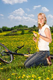 Woman with bicycle Stock Images