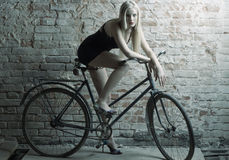 woman with a bicycle Stock Images