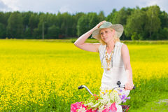 Woman and bicycle Royalty Free Stock Photos