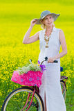 Woman and bicycle Royalty Free Stock Image