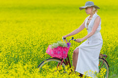Woman and bicycle Stock Photography