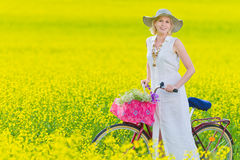 Woman and bicycle Royalty Free Stock Images