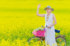 Woman and bicycle Stock Image