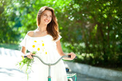 Woman and bicycle Stock Photos