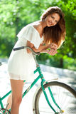 Woman and bicycle Royalty Free Stock Photography