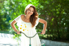 Woman and bicycle Stock Photo