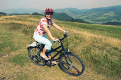 Woman on a bicycle. In Pieniny National Park Royalty Free Stock Images