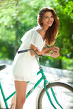Woman and bicycle Stock Images