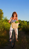 Woman on bicycle Stock Photography