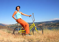 Woman with bicycle Royalty Free Stock Photos