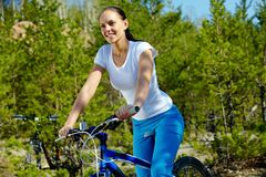Woman on bicycle Stock Image