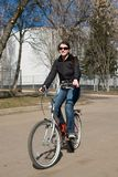 Woman on a bicycle Royalty Free Stock Photography