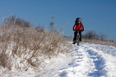 Woman on the bicycle. In winter Stock Photo