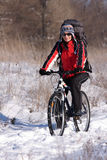 Woman on the bicycle. In winter Stock Photography