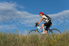 Woman on the bicycle Stock Images