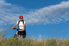 Woman on the bicycle Royalty Free Stock Photo