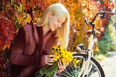 Woman with bicycle autumn garden. Weekend activity. Active leisure and lifestyle. Girl ride bicycle for fun. Blonde. Enjoy relax park garden. Autumn bouquet stock photography