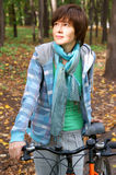 Woman with bicycle in autumn park Royalty Free Stock Image