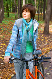Woman with bicycle in autumn park Royalty Free Stock Images