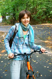 Woman with bicycle in autumn park Stock Image