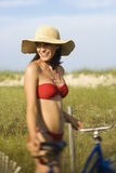 Woman with Bicycle at Beach Stock Image