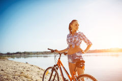 Woman on a bicycle in beach Stock Photo