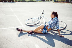 Woman on a bicycle in beach Royalty Free Stock Image