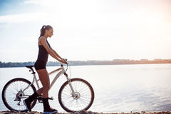 Woman on a bicycle in beach Stock Photos