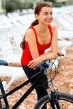 Woman with bicycle on the beach Stock Images