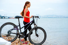 Woman with bicycle on the beach Royalty Free Stock Image